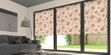 Three Chrysanth Scarlet Roller Blinds in a lounge