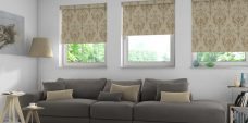 Three Distinction Champagne Roller Blinds in a living room