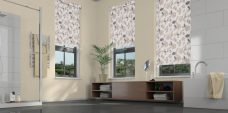 Three Flair neutral Eclipse roller blinds in a bathroom
