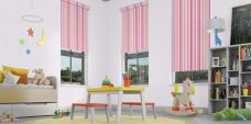 Three Funky Stripe Candy roller blinds in a child's room