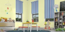 Three Funky Stripe Sky Roller Blinds in a child's room