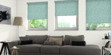 Three Fusion Jade Roller Blinds in a lounge setting