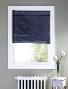 Harmony Bilberry Roman Blind in a recess window