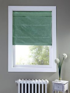 Harmony Verdigris Roman Blind in a recess window