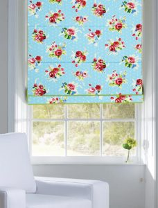 Jessamy Blue Haze Roman Blind set in a recess window