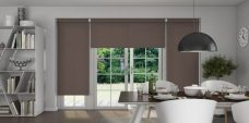 Three Linenweave Espresso Roller Blinds in a dining room setting