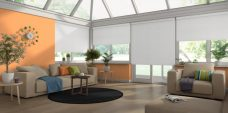 Four Linenweave Moonsoon Roller Blinds in a conservatory