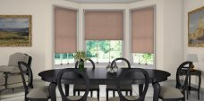 Three Linenweave Tweed Roller Blinds in a dining room setting