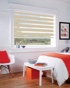 Milan Sand Duplex Roman Blind set in a bedroom