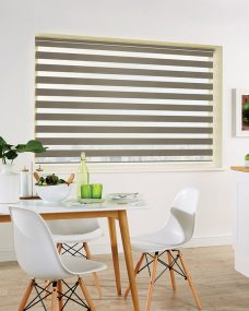 Milan Taupe Duplex Roman Blind set in a kitchen diner