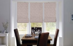 Three Mode Pebble Roman Blinds in a recess fitted window