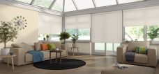 Four Nordic Ice Solar Reflective Roller Blinds in a conservatory setting