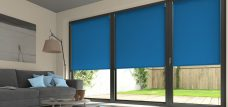 Three Palette Atlantic Blue Roller Blinds in a lounge