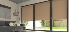 Three Palette Brown Sugar Roller Blinds in a lounge