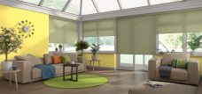 Four Palette Green Roller Blinds in a conservatory