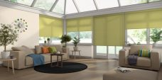 Four Palette Lime Green Roller Blinds in a conservatory