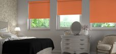 Three Palette Mandarin Roller Blinds in a bedroom