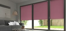 Three Palette Plum Roller Blinds in a lounge