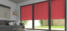 Three Palette Redcurrant Roller Blinds in a lounge