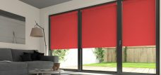 Three Palette Scarlet Roller Blinds in a lounge