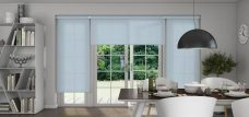 Three Palette Smokey Blue Roller Blinds in a dining room