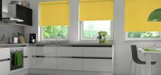 Palette Sunflower Roller Blind -A bright yellow blind in a grey walled kitchen