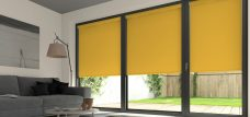 Three Palette Turmeric Roller Blinds in a lounge