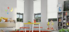 Three Palette White Roller Blinds in a child's room