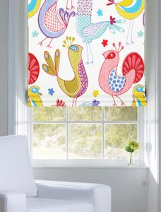 Paradise Prussian Roman Blind set in a recess window