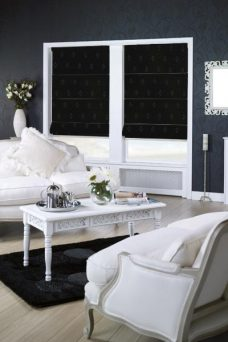 Two Robin Black Roman Blinds Fitted in a lounge setting
