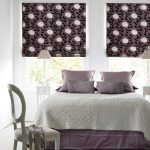 Two Romantica Loganberry Roman Blinds in a bedroom setting