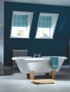 Two Rubus Teal Roman Blinds set in a bathroom setting