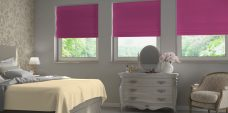 Three Sandbach Bubblegum Roman Blinds set in recess bedroom windows