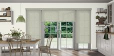 Three Shantung Leaf Roller Blinds set in a kitchen