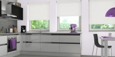 Three Shantung White Roller Blinds set in a kitchen