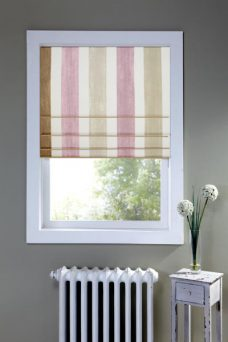Sheridan Tea Rose Roman Blind set in the a recess window