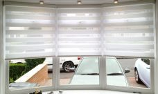 Three Sienna White Duplex Blinds in a bay window