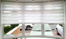 Three Sienna White Duplex Blinds in a bay window