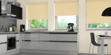Three Topaz Gold Roller Blinds in a kitchen setting