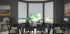 Three Topaz Silver Roller Blinds set in a dining room
