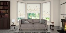 Three Vine And Butterfly Sable Roller Blinds set in a lounge