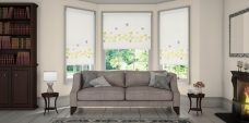 Three Vine And Butterfly Spring Roller Blinds set in a lounge