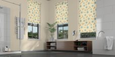 Three Virtue Bluebell Roller Blinds set in a bathroom