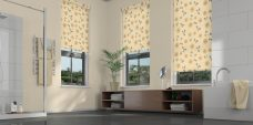 Three Virtue Oatmeal Roller Blinds set in a bathroom
