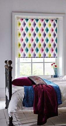 Amoura Roller Motorised Blind set in a bedroom