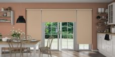 3 Aqua Safe Apricot Senses Roller Blinds in a kitchen