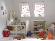 Bubbles Pink Roller Blinds in a child's nursery