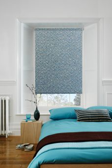 Cairo Stone Blue Roller Blind in a bedroom