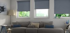 Three Cavalli charcoal Senses roller blinds in a lounge