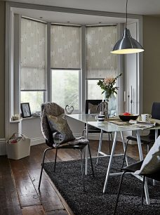 Comice Whisper Roller Blinds in a dining room
